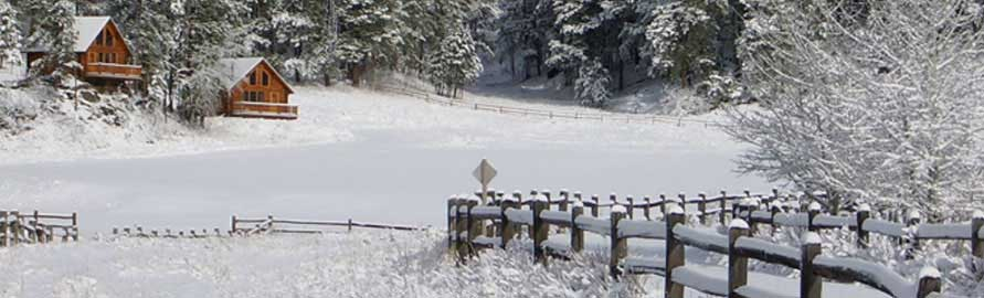 Snows blankets Newton Fork Ranch cabins in the Winter